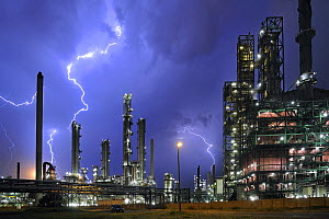 Lightning during thunderstorm above petrochemical industry in the Antwerp harbour, Belgium (digital composite to combine two lightnings). July 2008.  -  Philippe Clement