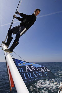 """Skipper Armel le Cleac'h standing on boom of Monohull Imoca 60ft """"Brit Air"""", Concarneau, Brittany, France. April 2008  -  Benoit Stichelbaut"""