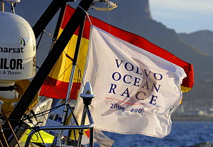 Flags aboard ^Telefonica Black^ as she arrives in Cape Town in 8th (last) place with a broken rudder and bow sprit, November 2008. Volvo Ocean Race 2008-09. For EDITORIAL USE only.  -  Rick Tomlinson
