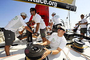 ^Green Dragon^ crew and ^Puma^ (background) in-port race training in Alicante, Spain, for the 10th Volvo Ocean Race 2008-2009. For EDITORIAL USE only.  -  Rick Tomlinson