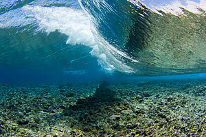Surf crashes on the reef off the island of Yap in Micronesia. September 2007.  -  David Fleetham