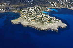 Aerial view of the limestone headland of Cap d'en Font located in the south east of Menorca, in the Mediterranean.  -  Francis Abbott