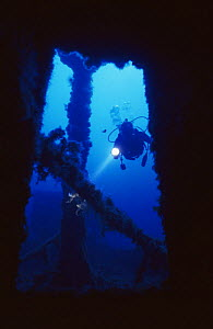 Diver explores wreck of ship 'The Santa', scuttled in July 1988 and now an artificial reef off Menorca, Mediterranean sea.  -  Francis Abbott