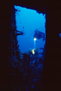 Diver explores wreck of 'The Santa', scuttled in July 1988 and now an artificial reef off Menorca, Mediterranean sea.  -  Francis Abbott