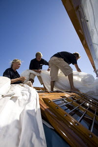 """Crew at work on board """"The Blue Peter"""" which was designed by Alfred Mylne and built by W. King & Sons of Burham-on-Crouch, length 19.6m. Panerai Classics, Sardinia, September 2007. - Richard Langdon"""