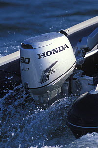 Honda 4-stroke outboard motor on rib, France, 2002. - Benoit Stichelbaut
