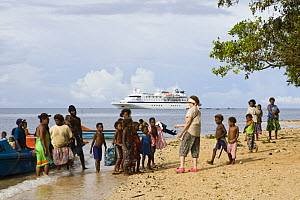 Locals greet tourists from the Clipper Odyssey tourist cruise boat, Nembao Village, Utupua Island, Solomon Islands May 2008 - Michele Westmorland