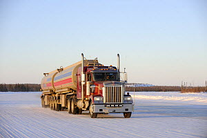Truck on the ice road transporting fuel to the mines, Northwest Territories, Canada  -  Eric Baccega