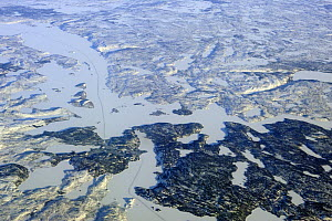 Aerial view of the ice road in the tundra connecting the gold mines to the city of Yellowknife, Northwest Territories, Canada  -  Eric Baccega