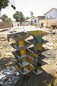 Pile of stoves made from scrap metal reclaimed from traditional taxis, The Gambia, 2008  -  Tom Gilks