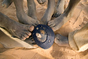 Feet touching a football made from old fabric, The Gambia, 2008  -  Tom Gilks