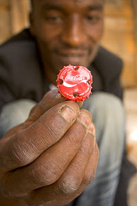 Close-up of Coke bottle top, prepared by artisan before crafting, Dakar, Senegal, 2008  -  Tom Gilks