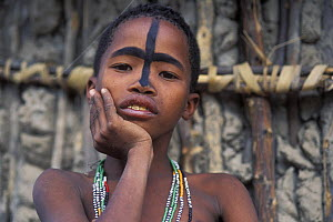 Young San Bushman with face decoration of oryx mask, Bushmanland, Namibia  -  Jouan & Rius