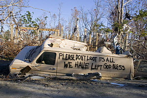 Note written by Hurricane Katrina victims on vehicle damged by hurricane, Gulfport, Mississippi, USA. August 2005  -  John Cancalosi