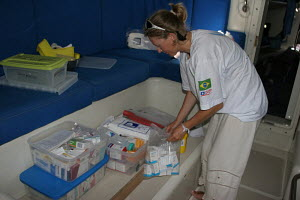 Yacht's doctor preparing medical supplies for a voyage, Clipper Race, October 2005. - Ingrid Abery