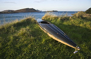 Kayak pulled up on bank at Lower Town Beach, St. Martin's, Isles of Scilly. December 2008.  -  Merryn Thomas
