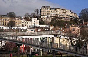 Cyclist on pedestrian flyover, with Clifton in the background. Hotwells Docks, Bristol. March 2009. - Merryn Thomas
