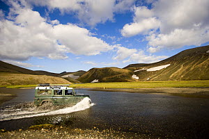 Crossing river with a Land Rover, Landmannalaugar mountains, central Iceland. July 2008  -  Inaki Relanzon