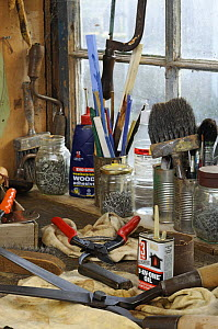 Garden tools, secateurs and shears on workshop bench, ready to be cleaned and sharpened, UK, December 2008  -  Gary K. Smith