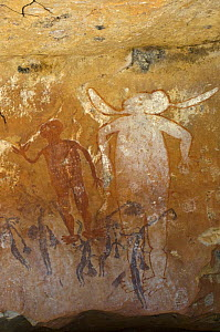 Ancient Wandjina figures painted over a much older panel of Bradshaw rock art, Northern Kimberley region and the Mitchell Plateau, Western Australia  -  Steven David Miller