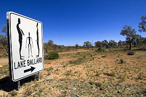 Sign to the Fifty-one carbonised statues, rendered from full body scans of the citizens of Menzies, now inhabit the dried salt bed of Lake Ballard. The statues were created by Antony Gormley for Perth...  -  Steven David Miller