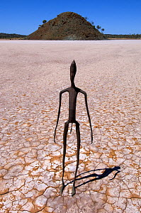 Fifty-one carbonised statues, rendered from full body scans of the citizens of Menzies, now inhabit the dried salt bed of Lake Ballard. The statues were created by Antony Gormley for Perth's 2003 Arts...  -  Steven David Miller