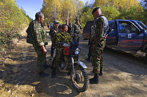 Siberian tiger anti-poaching patrol stopping and searching people on forest road, 600 miles north of Vladivostok, Primorksy, Russian Far East, October 2005  -  Mark Carwardine