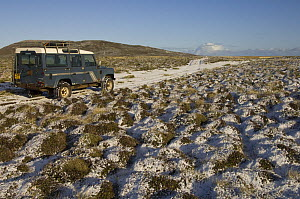 Light covering of snow with a Land Rover on a small track, Pebble Island, off north coast of West Falkland, Falkland Islands, November 2007  -  Pete Oxford