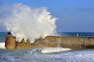 Wave crashing over jetty during storm at Saint-Val�ry-en-Caux, Normandy, France, December 2008  -  Philippe Clement