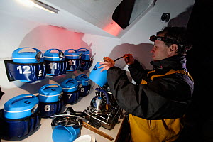 Cooking numbered rations aboard Maxi yacht ^Banque Populaire V^, skippered by Pascal Bidegorry, practicing off Cadiz, Spain. March 2009.  -  Benoit Stichelbaut