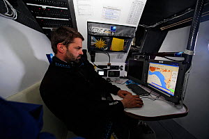 "Skipper Pascal Bidegorry in the navigation room aboard Maxi yacht ""Banque Populaire V"", practicing off Cadiz, Spain. March 2009.  -  Benoit Stichelbaut"