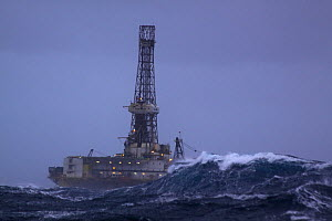 Oil drilling rig ^John Shaw^, situated at the Don oilfield 240 miles North East of Aberdeen, in heavy seas. North Sea, 2009.  -  Philip Stephen