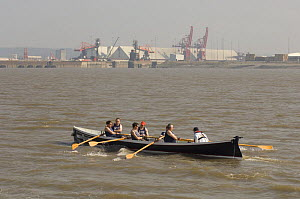 """""""Bedehaven"""" rowers in the Bristol Gig Club """"Bristol Challenge"""" race with Portbury Docks in the background. March 21st 2009.  -  Rob Cousins"""