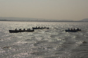 """Rowers in the """"Bristol Challenge"""" race off Portishead, in the Bristol Channel. March 21st 2009.  -  Rob Cousins"""