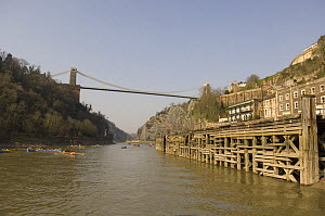 """Clifton Suspension Bridge and old wharf at Hotwells, Bristol, with gigs having just finished the """"Bristol Challenge"""" race through the gorge. March 21st 2009. - Rob Cousins"""
