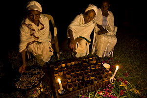 Ethiopian women preparing coffee (Coffea arabica) according to traditional ceremony. After roasting the coffee, this is pounded and boiled in terracotta pitcher,  Bonga, Kaffa Zone, Southern Ethiopia...  -  Bruno D'Amicis