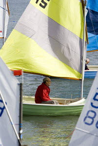 YSC Scow getting ready to go out for a sail, amongst Optimists, on the river Yar, Yarmouth, Isle of Wight. May 2009 - Richard Langdon