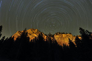 Mountains with star trails in the sky, Cheile Bicazului-Hasmas National Park, Carpathian Mountains, Transylvania, Romania, October 2008. WWE OUTDOOR EXHIBITION.  -  Wild Wonders of Europe / Döerr