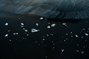 Glacier ice laying on black volcanic sand. �r�fi, Iceland.June 2008 - Orsolya Haarberg