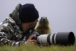 Photographer, Grzegorz Lesniewski with marmot, model released, Hohe Tauern National Park, July 2008 WWE OUTDOOR EXHIBITION. WWE BOOK.  -  Wild Wonders of Europe / Lesniew