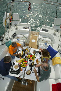 Friends eating breakfast aboard Stephens 53 in Florida Bay, Florida, USA.  Model and property released.  -  Billy Black