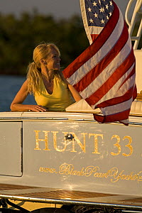 Woman aboard Surf Hunter 33 Jet boat off Marco Island, Florida. Model and property released.  -  Billy Black
