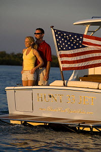 Couple aboard Surf Hunter 33 Jet boat off Marco Island, Florida. Model and property released.  -  Billy Black