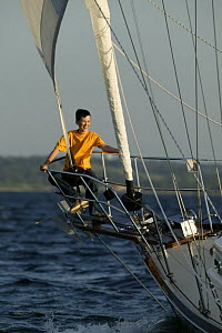 Boy in pulpit of Shannon 42 yacht sailing in Narragansett Bay, Newport, Rhode Island. June 2005.  Model and property released.  -  Billy Black