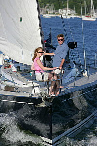 """Couple in pulpit of Swan 60 """"Extraordinary"""", sailing on Narragansett Bay, Rhode Island. Model Released, July 2005.  -  Billy Black"""