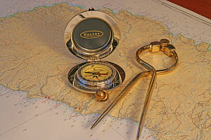 Compass and dividers aboard cruising yacht. - Billy Black