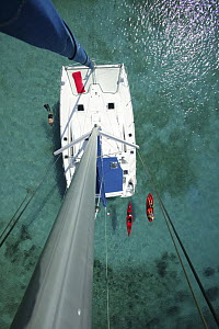 """Kayak, snorkeler and open kayak viewed from the masthead of Moorings charter catamaran """"Pitch Pin"""", British Virgin Islands. January 2004. Model and property released.  -  Billy Black"""