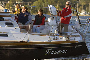 """Family sailing Tartan 4300 """"Tsunami"""" on the Severn River, Maryland. Model and property released, October 2007. - Billy Black"""