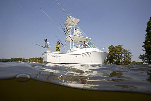 People fishing from the stern of a sportsfisher.  Model and property released.  -  Billy Black