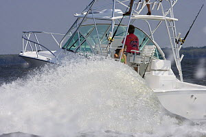 Large wake from motoring sportsfisher.  Model and property released. - Billy Black